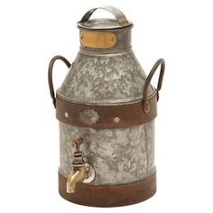 "Decorative galvanized metal milk jug with banded accents.  Product: Milk canConstruction Material: MetalColor: Silver and copperDimensions: 13"" H x 8"" W x 7"" D"