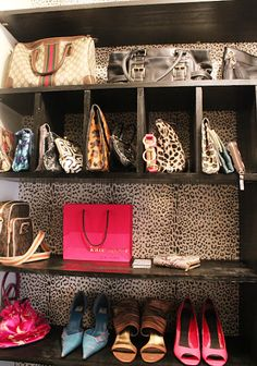shelving for handbag storage and organization with leopard wallpaper #storage