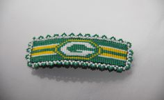 I designed my loom pattern and made a loomed barrette for Amanda. She is a fan of Green Bay Packers.