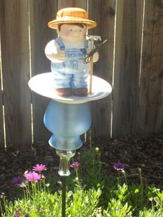 Farmer Yard Art- like the small base vase inside larger for stability. Looks like a Cookie Jar, Great Idea!