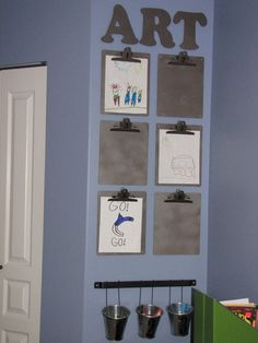 Don't necessarily like the color but mounted clipboards on a bulletin board to display art. Kind of neat