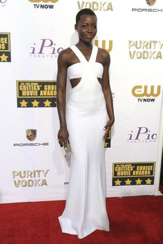 Lupita Nyong'o in a custom Calvin Klein Collection bandeau dress at the 19th annual Critics' Choice Movie Awards. [Photo by Amy Graves]