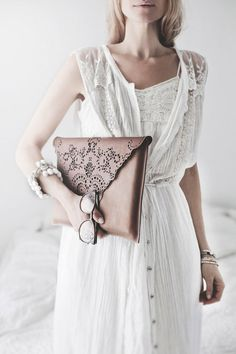 Oversized leather envelope clutch with intricate cut out detail