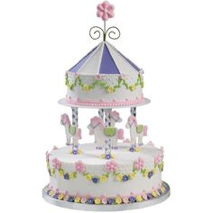 Celebrate carnival style. Sculpt an eye-catching merry-go-round carousel birthday cake.