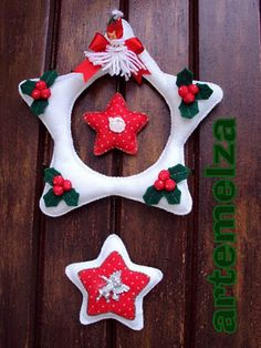 guirlanda de natal feita em feltro pap e moldes    http://www.dicasdeartesanatos.com.br/2011/11/guirlanda-feltro-natal.html#