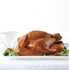 Brining Apple Sage Brined Turkey with kosher salt and herbs ensures every slice is moist and juicy.