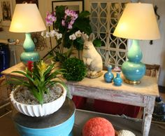 Blue #ChristopherSpitzmiller #lamps and #rabbit #statues and #garden greenery at  #Chicago #Mecox #interiordesign #MecoxGardens #furniture #shopping #home #decor #design #room #designidea #vintage #antique #garden