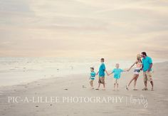 Family beach photo shoot.  Let the children be pulling toward the water like they're anxious to get in it.