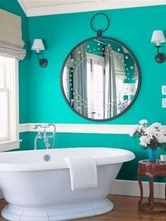 Bright, turquoise bathroom, with a beautiful accent mirror piece. Get the look with Dunn-Edwards Teal Me No Lies DE5732.