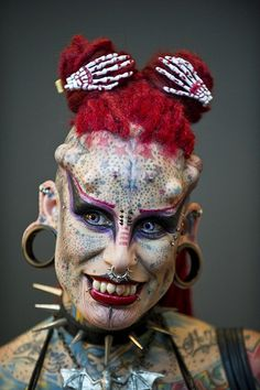 and as far as I know Maria Jose Cristerna (Mexico) aka Vampire Woman is a mother of four, a lawyer and a woman with the highest number of body modifications