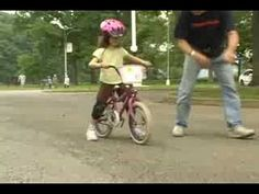 Teach Your Child To Ride A Bike in one day.  No training wheels.