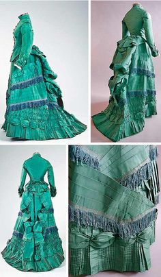 Visiting gown, ca. 1875. Taffeta, with stand collar, low-waisted, cuirasse-shaped bodice with domed needlepoint covered buttons, and Brussels lace at the cuffs. Skirt has elaborate vertical and diagonal pleated bands and ruched panels, which culminate in a bouffant bustle with large bow, adorned with lavender-blue crimped fringes. Kerry Taylor/Invaluable Auctions