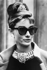 "Audrey Hepburn in her Cat's eye ""Manhattan sunglasses by Oliver Goldsmith in Breakfast at Tiffany's"