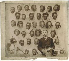 [Collections and colonies] Major General Horatio Gordon Robley with his collection of tattooed heads.