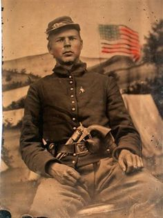 Civil War Soldier In Uniform With Revolver In Buckle Also Flag Backdrop Tintype