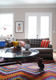 gray sofa + colorful kilim rug