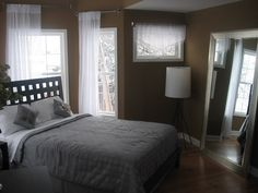 Small Master Bedroom in Brwon Color Scheme Picture