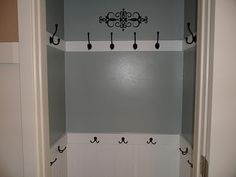 coat closet....more likely to hang coats in here than on a hanger..... Also for bags and kids.  Omgosh! Love this idea!