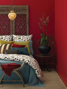 I WANT this bedroom. I have red walls but a lime green bedspread with cool pillows