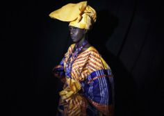 A model wears a creation by Nigerien Tuareg designer Alphadi (Sidahmed Seidnaly) backstage during the 10th anniversary of Dakar Fashion Week. Photo: Reuters