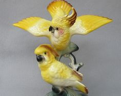 Maddux of Calif. Yellow Cockatoo Duo can be found at Antique Beak