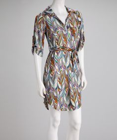 Sun-drenched days demand the appearance of dresses like this festive frock. Fetching colors swirl across it in a marbled design, while a front-tying belt cinches a shapely waist.Measurements (size S): 39'' long from high point of shoulder to hem92% polyester / 8% spandexMachine wash; hang dry