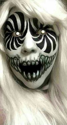 Halloween makeup. this is pretty much insane but sweet! Looks kinda like the American Horror Story Freak Show Clown!