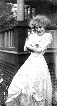 "Illustrator Nell Brinkley and a little friend - 1908  In 1907, at the tender age of twenty-two, Nell Brinkley came to New York to draw for the Hearst syndicate. Within a year, she had become a household name. Flo Ziegfeld dressed his dancers as ""Brinkley Girls,"" in the Ziegfeld Follies. Three popular songs were written about her. Women, aspiring to the masses of curly hair with which Nell adorned her creations, could buy Nell Brinkley Hair Curlers for ten cents a card. Young girls cut out and sa"