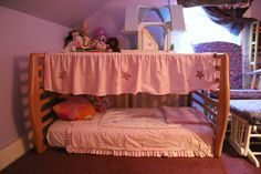 Repurposed crib into a canopy toddler bed with storage on top!  Simply by flipping it on its side, then putting the crib mattress back in, and using the cribsets bedskirt for the canopy top:)