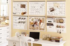 Above desk organization - complete with dry erase calendars and wall pockets. Inspiring.