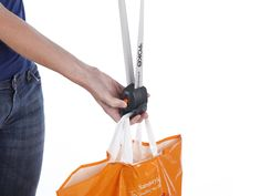 Yoke Shopper Innovative shopping tool that makes carrying multiple plastic bags less uncomfortable by letting you support their weight on your shoulder