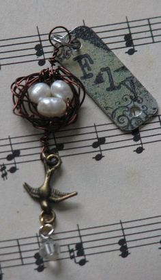 how to make a bird-themed altered charm.