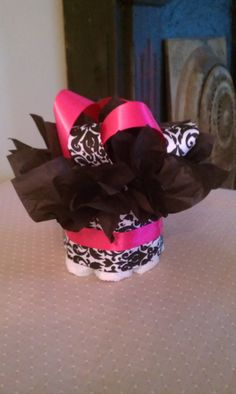 HOT Pink and white and black damask print Boutique mini diaper cake perfect for a baby girls baby shower centerpiece. $8.00, via Etsy.