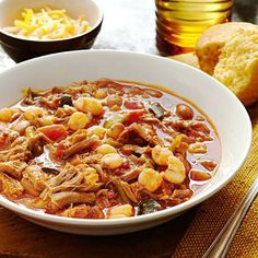 Shredded Pork Posole: Hominy is the signature ingredient in this traditional, chililike Mexican soup.