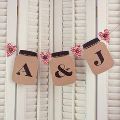The trend of mason jars and monograms come together in this adorable wedding banner. Kraft paper, buttons and twine really set the tone for this creation. See more at www.accucutcraft.com