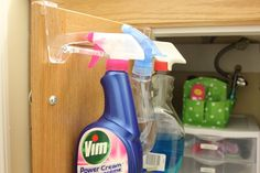 Towel bar as cleaner holder. Genius. I like this much better than a tension rod that goes across the whole cabinet!