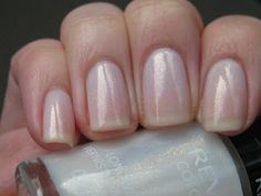 Revlon - Calla Lily. Not my nails. A lovely sheer white, with gold and copper flecks that show up much better in person.