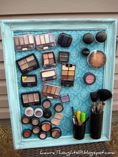 put magnets on the back of your makeup and stick them to a metal sheet in a frame