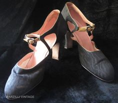 "Strappy 1920's Spanish heel shoes in black moiré silk with gold piping and amber paste encrusted buckles. These stylish vintage shoes have D-shaped cutwork sides piped in gold, separate gold leather belts that draw the uppers together and 2 1/2-inch heels. Stamped ""Marshall Field & Co., Chicago, Made With Narrow Heel"""