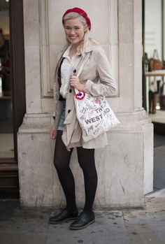 Ooh la la! With her scarlet beret and classic trench Ellie's stye nods to Parisian style; yet the quirky home-made bag and cute denim cut-offs  channel a distinctly London look. www.handbag.com
