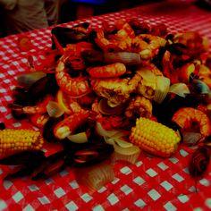 Crab boil.. Includes crab legs, shrimp, mussels, craw fish, sausage, potatoes, corn, onions, and some cajun seasoning :) num