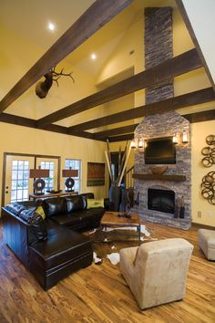 Wood beams in this two story great room.  Country House Plan # 151177.
