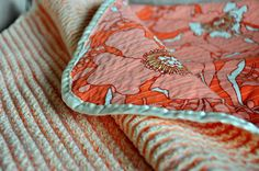 Nice tutorial on how to make a chenille blanket with one layer of cotton fabric and 3 layers of flannel