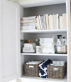 I like the use of straw and wire baskets for storage in bathroom. Think I'll do this in bathroom, since there is no door on that closet. Make it look prettier and neater.