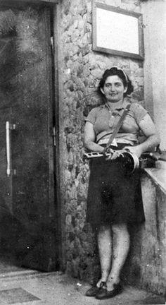 A female partisan armed with a sub-machine gun.