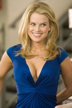 Alice Eve cleavage in a plunging blue dress