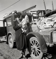 """February 1937. """"Tracy (vicinity), California. U.S. Highway 99. Missouri family of five, seven months from the drought area. Broke, baby sick, car trouble."""" Photo by Dorothea Lange for the Farm Security Administration"""