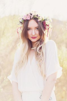 Love the colors in the wreath head  piece, and the soft muted background.  The ethereal white dress is lovely...