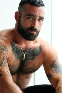 tattoos, beard, hairy chest, light eyes, nice arms...everything I LUV!!!!!