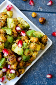 Avocado and Chickpea Salad with Pomegranates is packed with nutritions. This is a scrumptious gluten free and vegetarian you can eat even as a snack.   giverecipe.com   #avocado